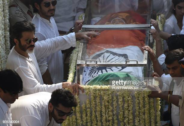 Indian Bollywood actor Anil Kapoor stands with the body of actress Sridevi Kapoor in the funeral cortege as they reach the crematorium for the final...