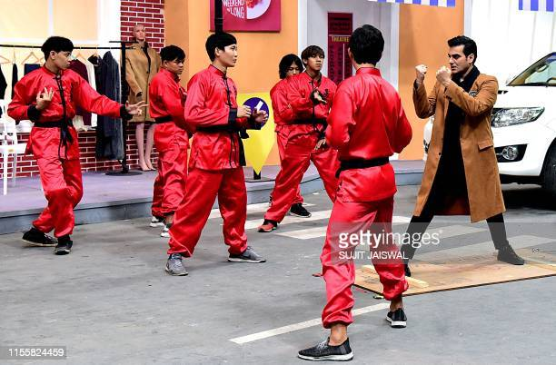 Indian Bollywood actor Arbaaz Khan along with Chinese stunt performers gestures during the shooting of the upcoming romantic thriller film 'Sridevi...