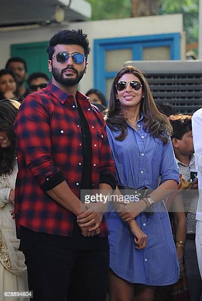 Indian Bollywood actor Arjun Kapoor and Sweta Bachchan attend the Muhurat of upcoming Marathi film Hrudayantar in Mumbai on December 10 2016 / AFP /