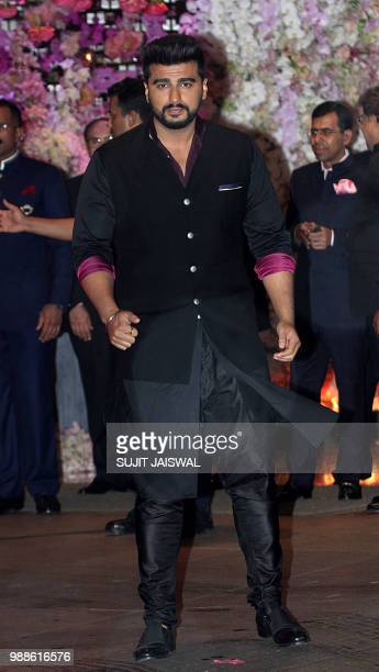 Indian Bollywood actor Arjun Kapoor poses for a picture at the preengagement party of India's richest man and Reliance Industries Limited Chairman...