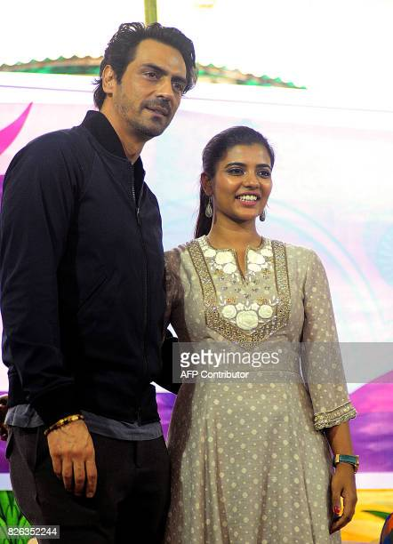 Indian Bollywood actor Arjun Rampal and South Indian actress Aishwarya Rajesh pose for a picture during a promotional event for the political crime...