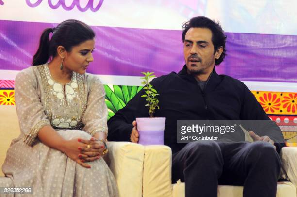 Indian Bollywood actor Arjun Rampal and South Indian actress Aishwarya Rajesh talk during a promotional event for the political crime drama Hindi...