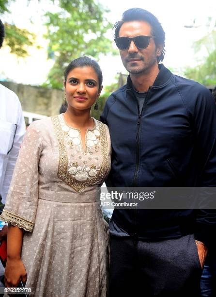 Indian Bollywood actor Arjun Rampal and South Indian actress Aishwarya Rajesh pose for a picture upon arriving to a promotional event for the...