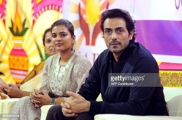 Indian Bollywood actor Arjun Rampal and South Indian actress Aishwarya Rajesh look on during a promotional event for the political crime drama Hindi...