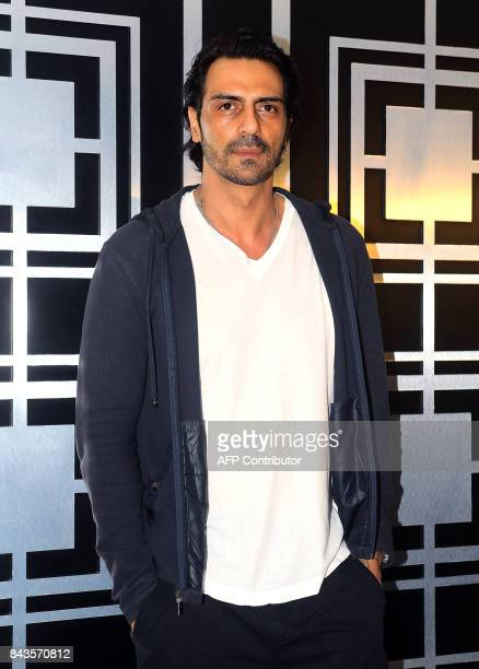 Indian Bollywood actor Arjun Rampal attends a screening of his political crime drama Hindi film 'Daddy' in Mumbai on September 6 2017 A movie about...
