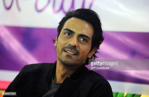 Indian Bollywood actor Arjun Rampal looks on during a promotional event of his political crime drama Hindi film 'Daddy' in Mumbai on August 4 2017 /...