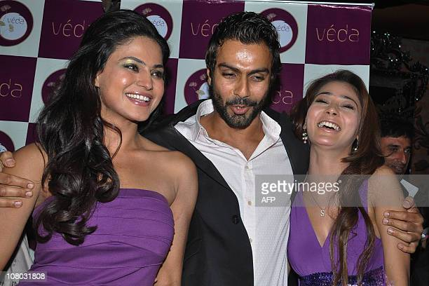 Indian Bollywood actor Ashmit Patel celebrates his 33th birthday and poses with Pakistani actress Veena Malik and Indian actress Sara Khan during the...