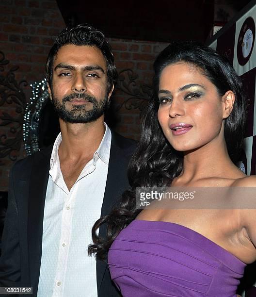 Indian Bollywood actor Ashmit Patel celebrates his birthday with Pakistani actress Veena Malik in Mumbai on January 13 2011 AFP PHOTO/STR