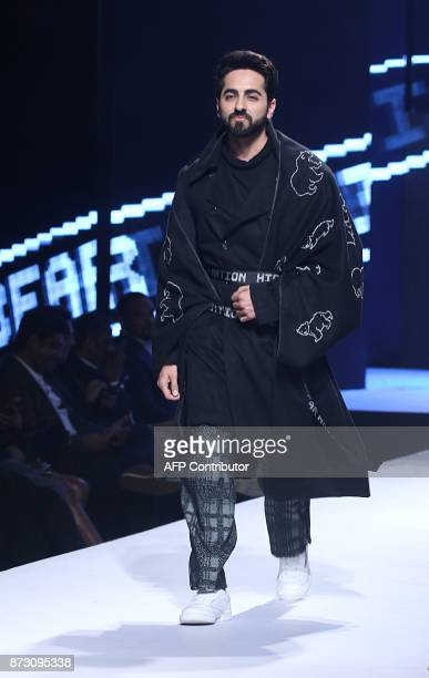 Indian Bollywood actor Ayushmann Khurrana showcases a creation by designer Sahil Aneja at the Van Heusen GQ Fashion Nights 2017 in Mumbai on November...