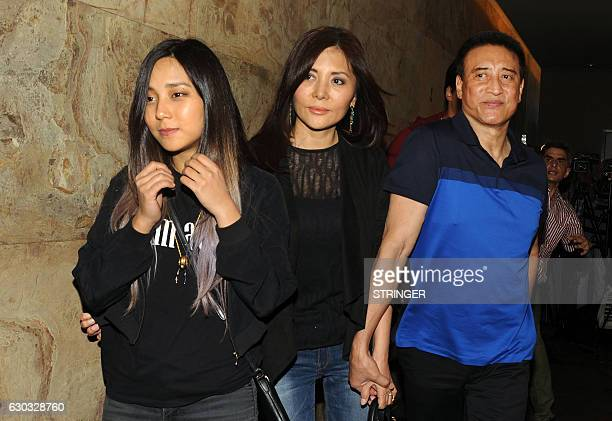Indian Bollywood actor Danny Denzongpa with family members attends the special screening of the biographical sports drama Hindi film 'Dangal' based...