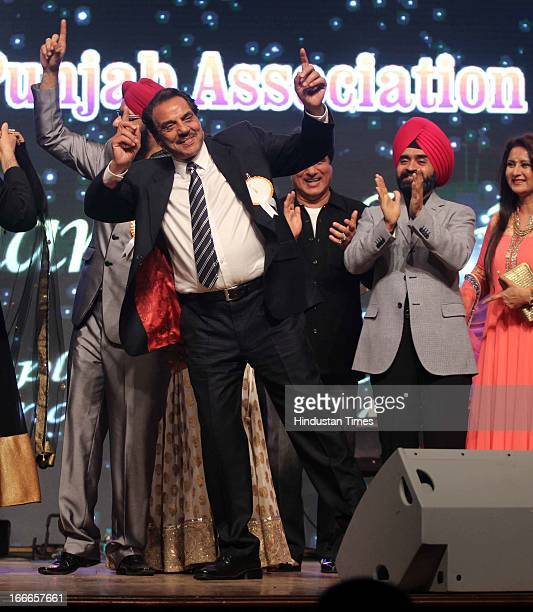 Indian bollywood actor Dharmendra doing Bhangra during Baisakhi Celebration cohosted by G S Bawa and Punjab Association Of India on April 13 2013 in...