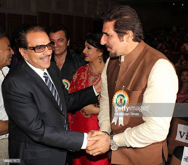 Indian Bollywood actor Dharmendra greets actor Mukesh Rishi at Baisakhi Celebration cohosted by G S Bawa and Punjab Association Of India on April 13...