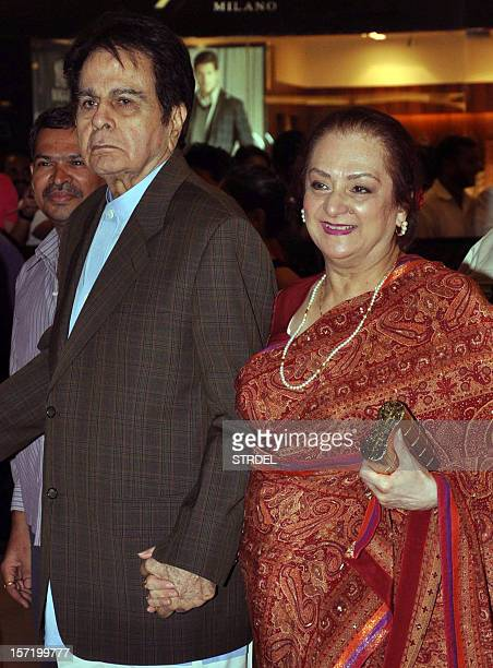 """Indian Bollywood actor Dilip Kumar and his wife Saira Banu arrive to attend the premier of Hindi film """"Talaash"""" directed by Reema Kagti in Mumbai..."""