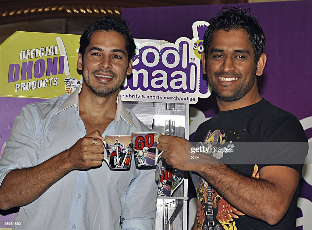 Indian bollywood actor Dino Morea (L) and Indian cricketer Mahendra Singh Dhoni (R) pose during a launch of Cool Maal official Dhoni merchandise in Mumbai on April 23, 2010.