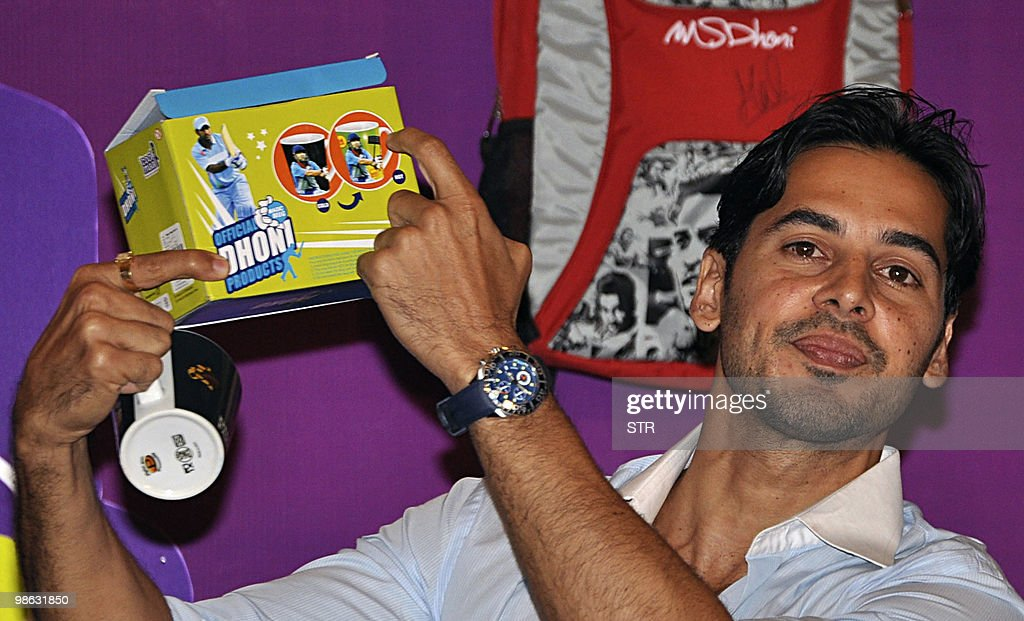 Indian bollywood actor Dino Morea poses during a launch of Cool Maal official Indian cricketer Mahendra Singh Dhoni merchandise in Mumbai on April 23, 2010.