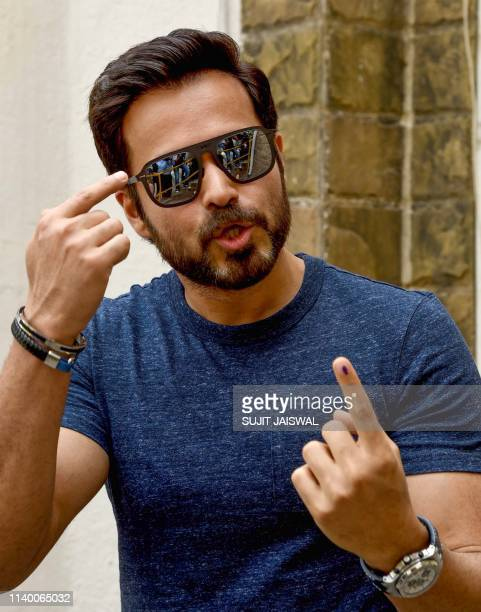 Indian Bollywood actor Emraan Hashmi poses for photographs after casting his vote at a polling station in Mumbai on April 29 2019 Voting began for...