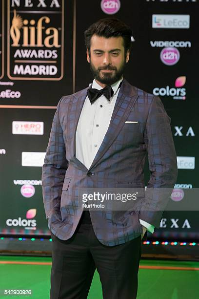 Indian Bollywood actor Fawad Khan poses on the green carpet as she arrives to the 17th edition of IIFA Awards in Madrid on June 24 2016