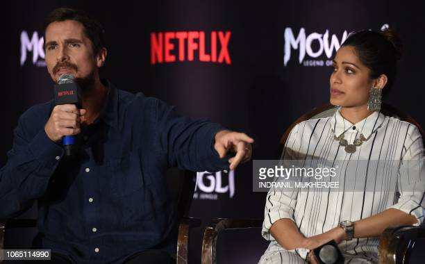 Indian Bollywood actor Freida pinto looks on as US actor Christian Bale speaks during a press conference for Netflix's 'Mowgli Legend of the Jungle'...