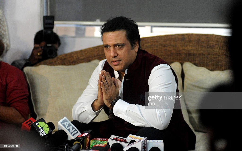 Indian Bollywood actor Govinda addresses the media during a press conference at his residence im Mumbai on December 1, 2015. The Indian Supreme Court on November 30 directed actor Govinda to apologize to his fan for slapping him in 2008. The apex court observed that a film actor should not indulge in fighting in a public place and asked the actor to settle the issue outside court by expressing regret for his conduct, in Mumbai on December 1, 2015.