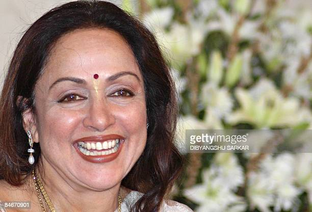 Indian Bollywood actor Hema Malini gestures as she attends the inaguration ceremony of the 3rd International Women's Conference in the Art Of Living...