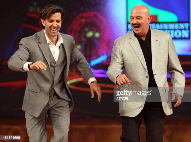 Indian Bollywood actor Hrithik Roshan and his father Rakesh Roshan dance during the annual 'Umang 2015 Mumbai Police Show' in Mumbai on late January...