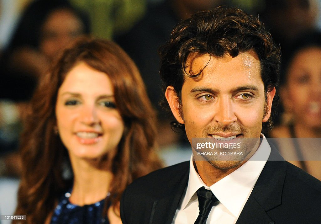 Indian Bollywood actor Hrithik Roshan and his wife Suzanne arrive at the International Indian Film Academy (IIFA) awards in Colombo on June 5, 2010. Bollywood actors arrived in Sri Lanka to attend the three-day International Indian Film Academy (IIFA) awards and surrounding events that begun in Colombo on June 3. AFP PHOTO/Ishara S. KODIKARA