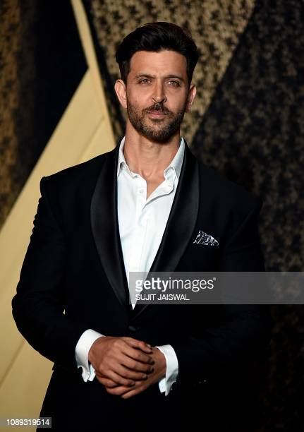 Indian Bollywood actor Hrithik Roshan poses for a picture during the wedding reception of film producer Mukesh Bhatt's daughter Sakshi Bhatt in...