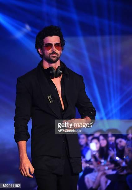 Indian Bollywood actor Hrithik Roshan showcases a creation by designer Nikhil Thampi during the Tech Fashion Tour Season 3 in Mumbai on late...