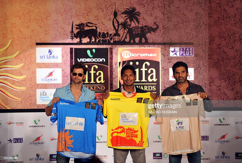 Indian Bollywood actor Hrithik Roshan, Sri Lankan cricketer Kumar Sangakkara and Indian Bollywood actor Suniel Shetty hold up cricket jerseys at a news conference in Mumbai on May 29, 2010 to promote The International Indian Film Academy (IIFA) awards. Sri Lanka will host top Indian movie stars for the annual 'Bollywood Oscars' weekend that showcases one of the world's most ambitious and prolific film industries. The June 3-5 event will feature performances, premieres, celebrity parties, workshops, business forums, fashion shows and a Twenty20 cricket match. AFP PHOTO Sajjad HUSSAIN