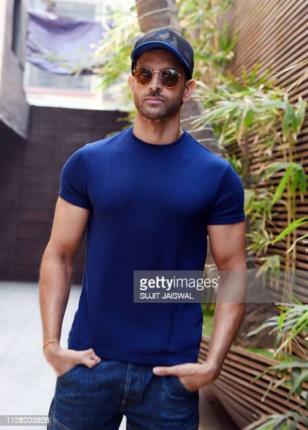 Indian Bollywood actor Hrithik Roshan takes part in a blessing event for the start of the upcoming film 'Smile Please' in Mumbai on March 1 2019