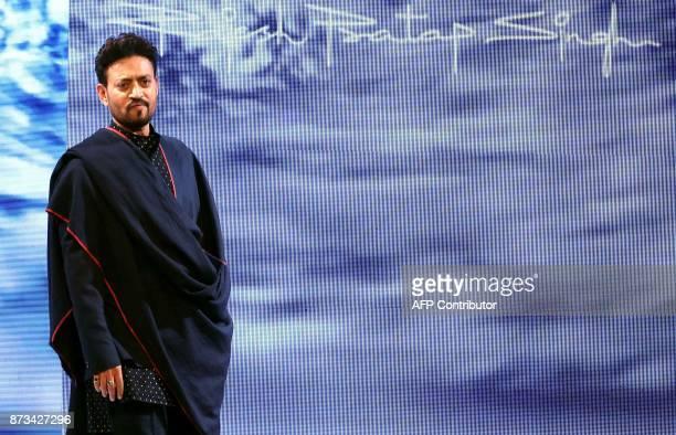 Indian Bollywood actor Irrfan Khan showcases a creation by designer Rajesh Pratap Singh at the Van Heusen GQ Fashion Nights 2017 in Mumbai on...