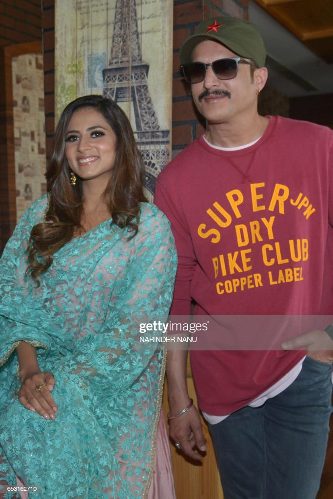 Indian Bollywood actor Jimmy Shergill and actress Sargun Mehta pose during a promotional event for the upcoming Punjabi film `Jindua` in Amritsar on..
