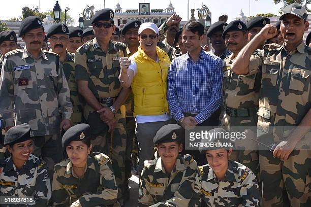 Indian Bollywood actor Jimmy Shergill and Border Security Force Deputy Inspector General Sumer Singh along with BSF personnel pose at a promotional...
