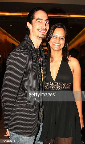 Indian bollywood actor Kabir Bedi�s son Adam Bedi stands with wife model and actress Nisha Harale Bedi at Lakme Fashion Week winter/festive 2010 in...