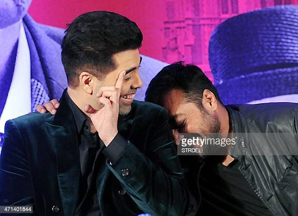Indian Bollywood actor Karan Johar and writer director and producer Anurag Kashyap share a light moment during a promotional event for the...