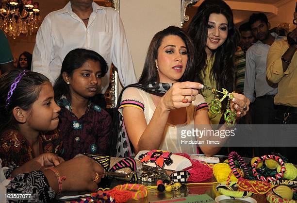 Indian bollywood actor Karisma Kapoor at fashion designer Archana Kochhar's store in Juhu on March 8, 2013 in Mumbai, India.