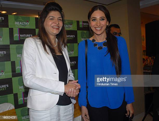 Indian bollywood actor Karisma Kapoor with Dr. Anjali Mukherjee during unveiling of Health food section of Godrej Nature Basket store at Hill road,...
