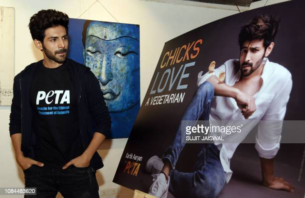 Indian Bollywood actor Kartik Aaryan poses for a picture during the launch of the latest print campaign of People for the Ethical Treatment of...