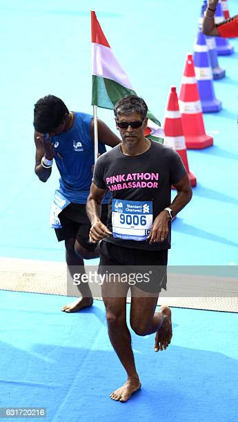 Indian Bollywood actor Milind Soman participates in the Standard Chartered Mumbai Marathon 2017 in Mumbai on January 15 2017 / AFP /