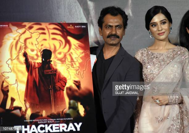 Indian Bollywood actor Nawazuddin Siddiqui and Amrita Rao pose during the trailer launch of the upcoming biographical drama Hindi film 'Thackeray' in...
