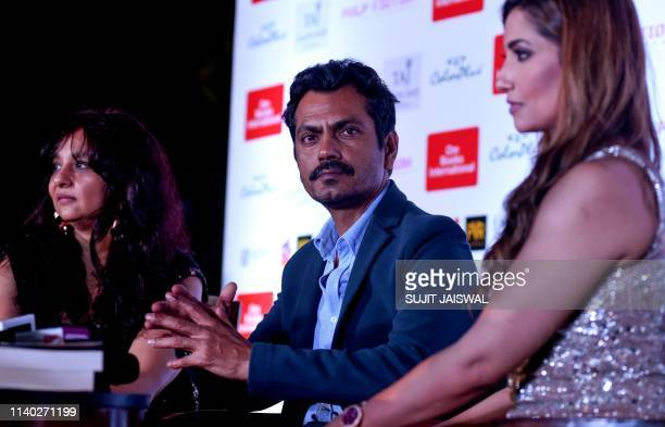 Indian Bollywood actor Nawazuddin Siddiqui looks on as he attends as a guest the launch of the book entitled 'The Stranger in Me' in Mumbai on April...