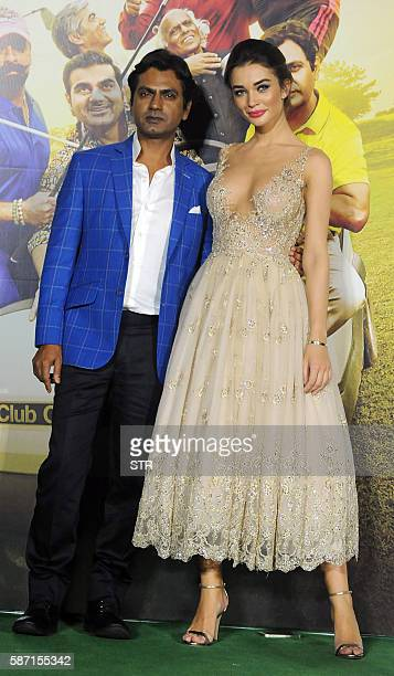 Indian Bollywood actor Nawazuddin Siddiqui poses with British actress Amy Jackson during the trailer launch of their home production Hindi film...