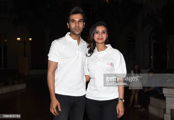 Indian Bollywood actor Rajkumar Rao and actress Patralekha pose for photographs during the campaign 'Sons #ShareTheLoad' led by detergent brand Ariel...
