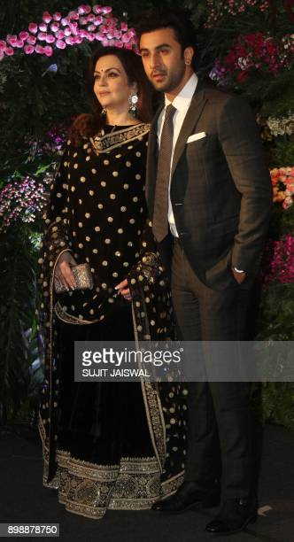 Indian Bollywood actor Ranbir Kapoor and Chairman of the Reliance Foundation Nita Ambani pose for a photograph during the wedding reception of the...