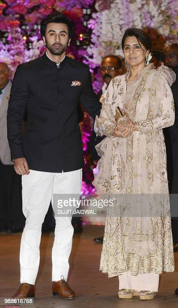 Indian Bollywood actor Ranbir Kapoor poses for a picture with his mother Neetu Singh as they attend the preengagement party of India's richest man...