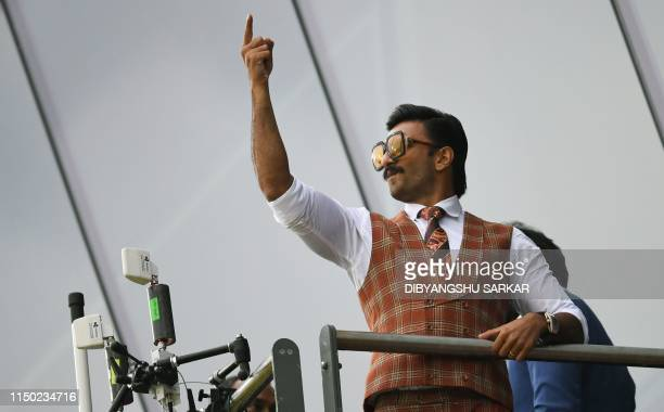 Indian Bollywood actor Ranveer Singh poses as he watches play during the 2019 Cricket World Cup group stage match between India and Pakistan at Old...