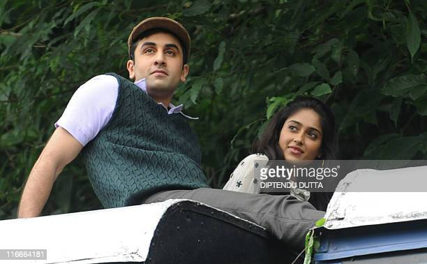 Indian Bollywood actor Ranvir Kapoor and actress Ileana D'Cruz ride atop a toy train in Tindharia hills some 35kms from Siliguri on June 17 during...