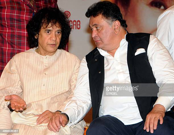 Indian Bollywood actor Rishi Kapoor and tabla player Zakir Hussain look on during the '72nd Master Deenanath Mangeshkar Awards' in Mumbai on late...
