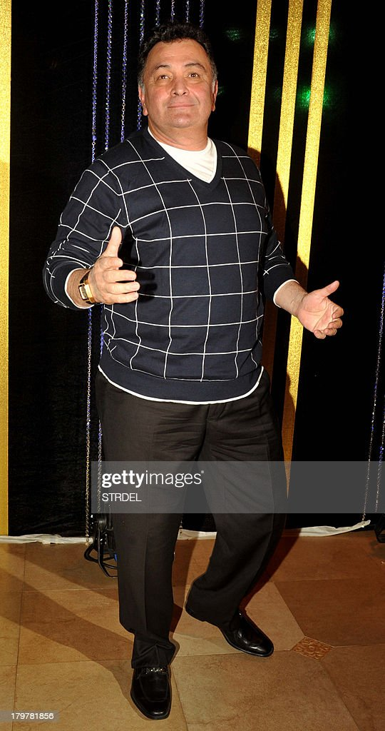 Indian Bollywood actor Rishi Kapoor poses during the 64th birthday celebrations for Indian Bollywood director Rakesh Roshan in Mumbai on September 6, 2013.
