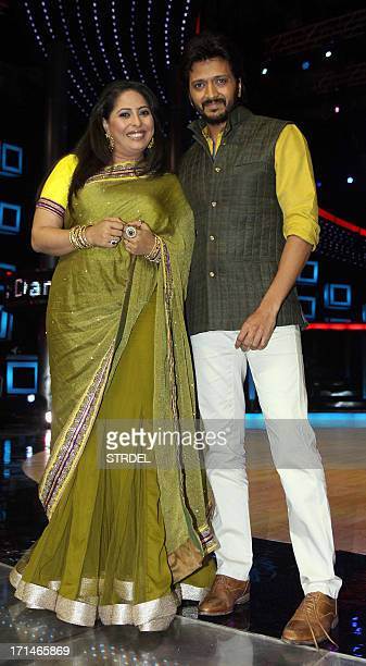Indian Bollywood actor Riteish Deshmukh poses with choreographer judge Geeta Kapoor during the promotion of the forthcoming Hindi film Bhaag Milkha...